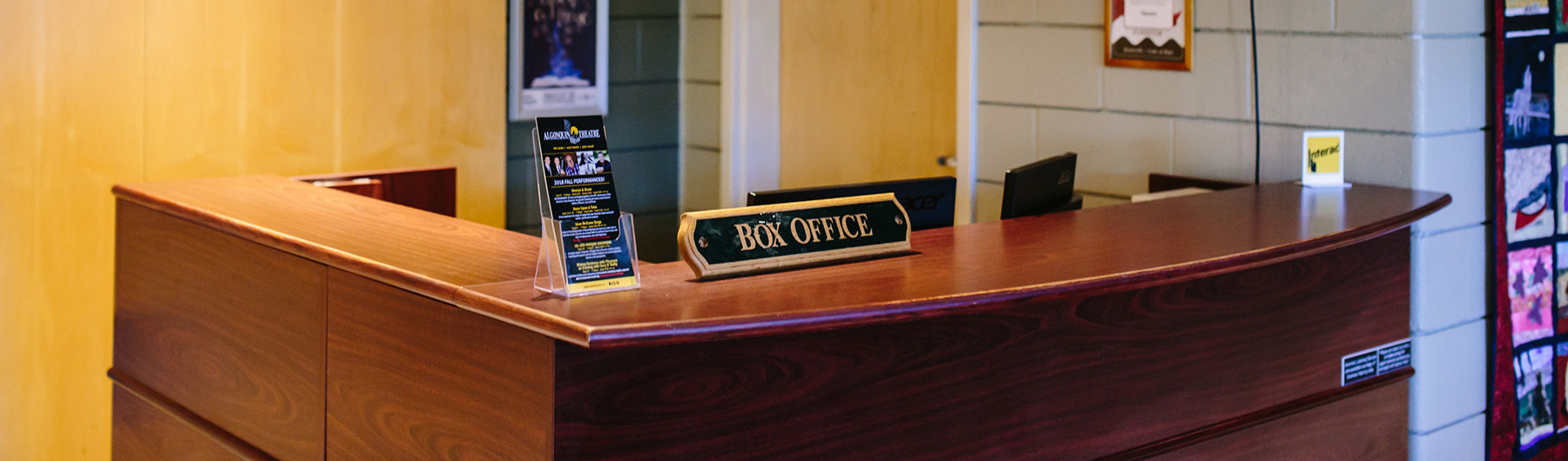 image of the desk with a sign that says Box Office