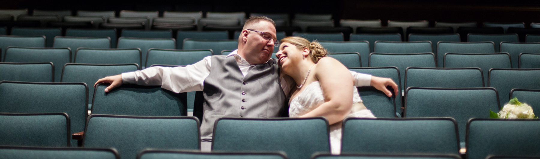 image of newlyweds in empty theatre space